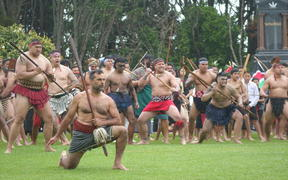 Hundreds of Māori toa, warriors, welcome officials on Owae Marae in Waitara for the commemorations of the New Zealand Land Wars.