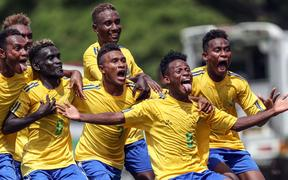 Solomon Islands players celebrate on their way to the World Cup
