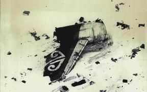 The tailpiece of the Air New Zealand bearing the 'Koru' the emblem of the airline lies amongst wreckage on Mt Erebus. The plane crashed on Wednesday killing all 257 people onboard. November 30, 1979. (Photo by Associated Press Photo)
