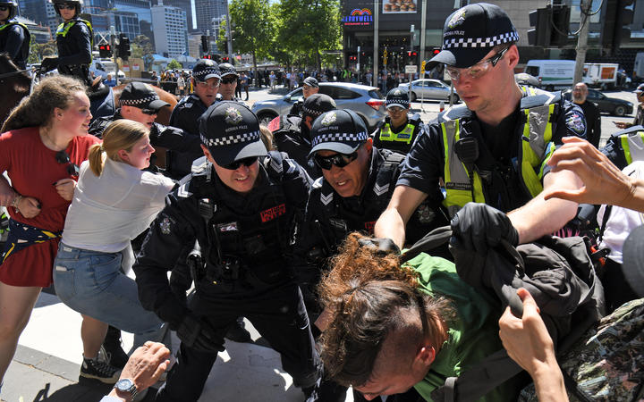 Police arrest a climate change protester outside the International Mining and Resources Conference (IMARC) being held in Melbourne on 29 October, 2019.