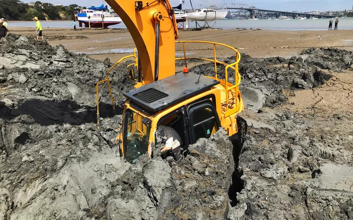 The digger becomes submerged up to its arm at high tide.
