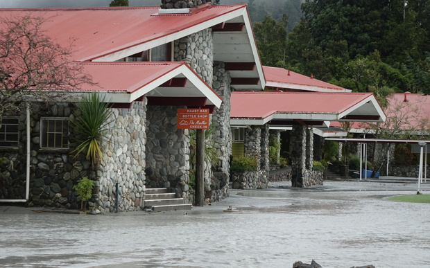 The Waiho River bursts its banks and runs through the Mueller Hotel in Franz Josef
