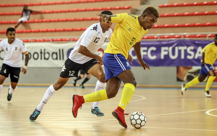 Solomon Island's Marlon Sia gets the better of Fiji's Anish Khem. OFC Futsal Nations Cup 2019.