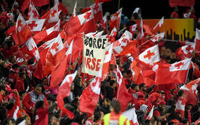 Tongan fans celebrate their team's win over Great Britain in Hamilton