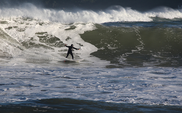 A surfer in Lyall Bay after a storm surge on June 14, 2015.