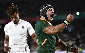 South Africa's wing Cheslin Kolbe celebrates after scoring his try.