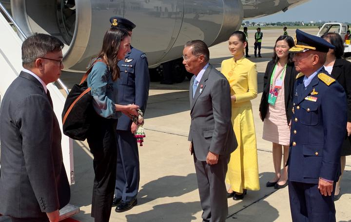 Prime Minister Jacinda Ardern is greeted by Thai's Minister of Labour, M.R. Chatu Mongol Sonakul, upon arrival to Bangkok for the East Asian Summit.