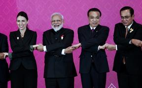 ASEAN leaders (L to R) Prime Minister Jacinda Ardern, Indian Prime Minister Narendra Modi, Premier of the State Council of the People's Republic of China Li Keqiang and Thailand Prime Minister Prayut Chan-o-Cha pose for a photo.