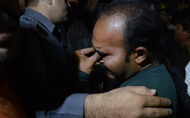A relative of a victim mourns after a suicide attack in a crowded park in Lahore.
