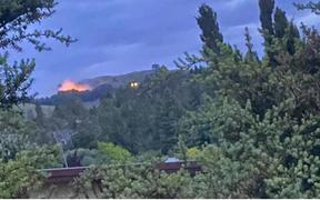 Fire crews battle a large blaze on Te Mata Peak.