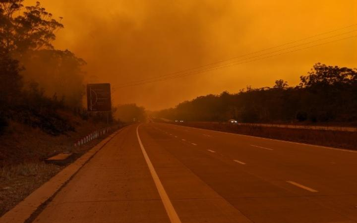 "The fires around Port Macquarie have given the entire region an eerie orange tinge, with one resident describing the scene as ""apocalyptic""."
