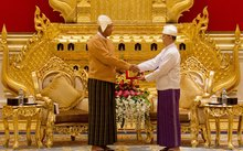 New Myanmar president Htin Kyaw, left, receives the presidential seal from outgoing president Thein Sein during the handover ceremony on 30 March.