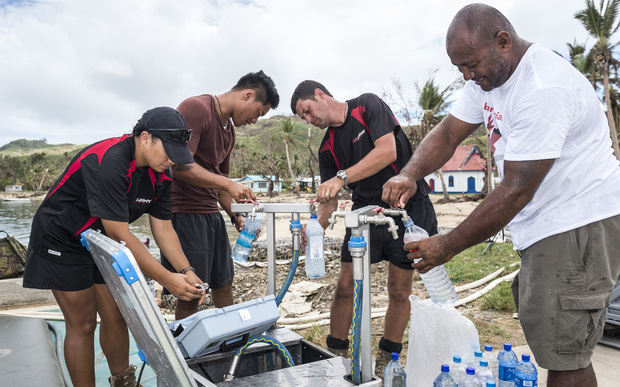 New Zealand army engineers help at a water desalination operation in Lomaloma village, Fiji after cyclone Winston.