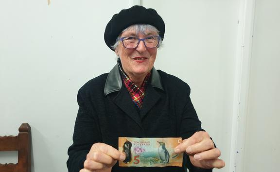 Grandmother Mary Lochore had already chipped in $10 to help pay for stethoscopes for midwives, here she waves $5 more.