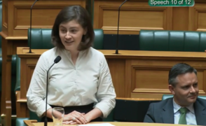 Green MP Chlöe Swarbrick speaking in parliament and responding to heckling with 'okay, Boomer'.