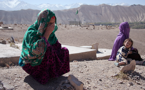 — Two of the mothers of the seven children who died in the blast on April, 2014, Baskul and Tohira, with one of Tohira's other children, at the cemetery where the children are buried.