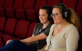 The APO's Katie Deller and Rowan Newton test out the new device to help those with hearing sensitivity at concerts