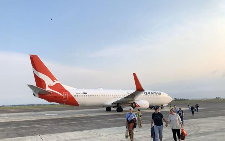 Passengers depart from the diverted Qantas plane.