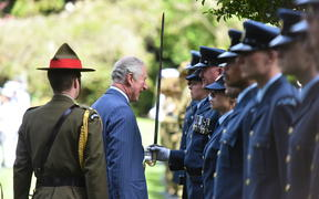 Prince Charles then inspected members of the armed forces lined up in the grounds of Government House.