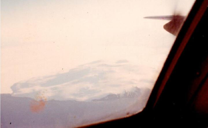 Flight Lieutenant Ray Robinson  took this photo of Mt Erebus out the cockpit window as the Hercules left to come home.