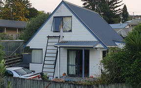 The Tauranga property where police shot a man they say had threatened a woman and child with a machete today.