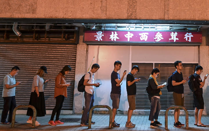 People queue to cast their vote during the district council elections in Tseung Kwan O district in Hong Kong.