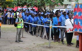 People queue at a referendum polling booth in Buka as voting gets underway in Bougainville for the autonomous PNG region's referendum on possible independence.