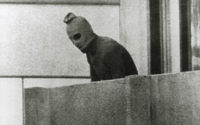 A Fairfax photographer captured one of the defining images of the Munich Olympics in 1972. This Palestinian is one of a group that had taken 12 Israeli athletes hostage.