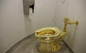 The fully functional 'America' toilet made from 18-karat gold has been opened in the Guggenheim Museum in Manhattan, New York City, USA, 16 September 2016. The toilet can and is to be used, but was also designed to be an artwork by Italian artist Maurizio Cattelan. Photo: CHRISTINA HORSTEN/dpa
