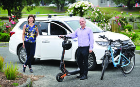 Rehette Stoltz with the new mayoral car – a Mitsubishi Outlander hybrid – and Gisborne District Council asset manager Simon Jeune with one of the council's e-scooters and an e-bike, which are part of a drive to get the council moving in an environmentally friendly way