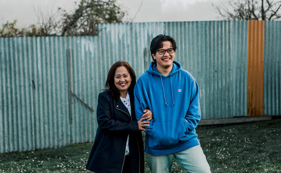 (L-R) Grace Trinidad and her son Joseph in their backyard in Waipawa, Hawke's Bay.