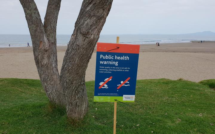 A swimming warning sign at Brown's Bay beach in Auckland.