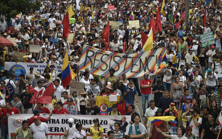 People take part in a march against the government of Colombian President Ivan Duque during a national strike, in Cali on November 27, 2019.