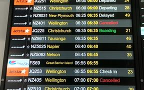 Airport flight board cancellations.
