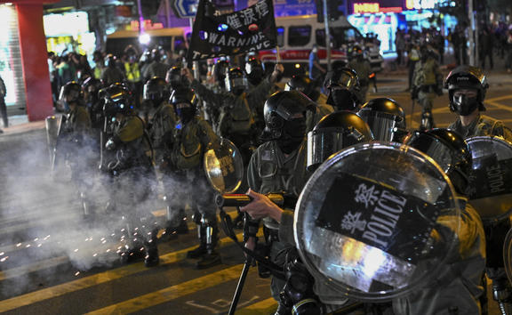 Police fire tear gas during a protest at Hung Hom area in Hong Kong on December 1, 2019.