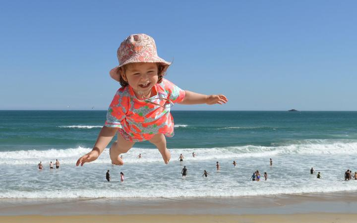 Flying visit . . . Olivia Naziris (20 months), from Wellington was one of many people who enjoyed the Dunedin beaches over the Christmas weekend. Hoisted high over St Kilda beach by her father Christopher, they were in Dunedin visiting family during the holidays.