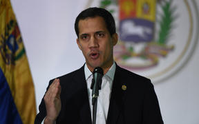 Venezuelan opposition leader and self-proclaimed acting president Juan Guaido speaks during a press conference in Caracas, on December 1, 2019.