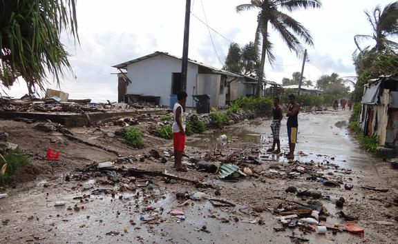 Majuro residents amid the debris from an ocean inundation in 2014