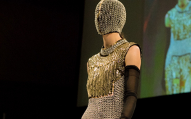 Yousef Akbar's mask and full beaded garments make a striking impact.