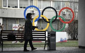 A woman smokes in front of the Russian Olympic Committee (ROC) headquarters in Moscow on November 26, 2019. - Russia's anti-doping chief said on November 26, 2019 he expected the country to be barred from all sporting competition for four years,