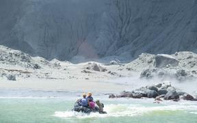 The White Island Tour operators rescue people from the island, just after the eruption.