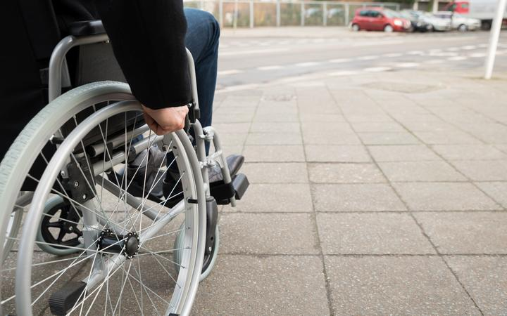 Close-up Of Disabled Man Sitting On Wheelchair