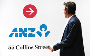 A man walks past an Australia and New Zealand Banking Group (ANZ) branch in Melbourne on October 31, 2019.