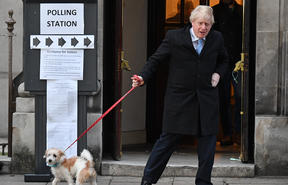 Boris Johnson - with his dog Dilyn  - leaves a polling station voting.
