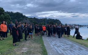 About 50 whānau, friends and members of the local community gather for a karakia at the cordon at the Whakatāne Boat Ramp.