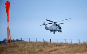 An airforce helicopter leaves Whakatāne Airport as it assists with the recovery of the eight bodies on White Island.