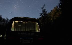 freedom camping. van. night time.