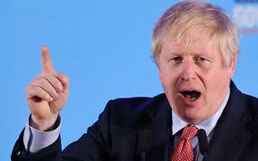 Britain's Prime Minister and leader of the Conservative Party, Boris Johnson speaks during a campaign event to celebrate the result of the General Election, in central London on December 13, 2019.