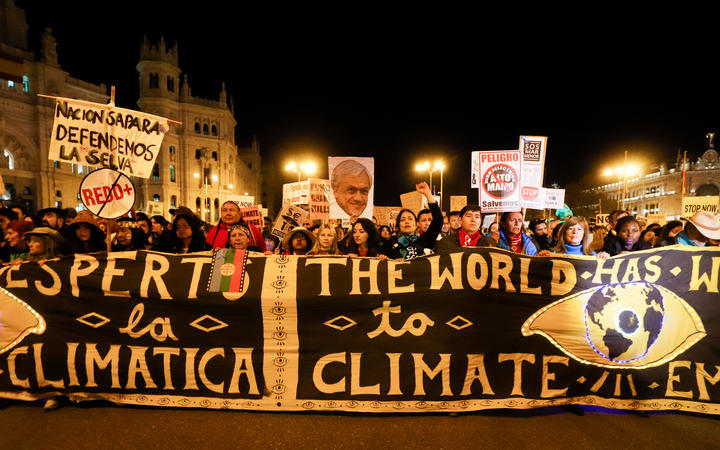 Demonstrators take part in the climate march on the fringes of the world climate conference.