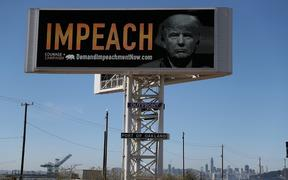 "OAKLAND, CA - SEPTEMBER 25: An electronic billboard next to the San Francisco-Oakland Bay Bridge reads ""IMPEACH"" with an image of U.S. President Donald Trump on September 25, 2017 in Oakland, California."